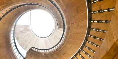 36342653 - view up a dramatic double spìral staircase.